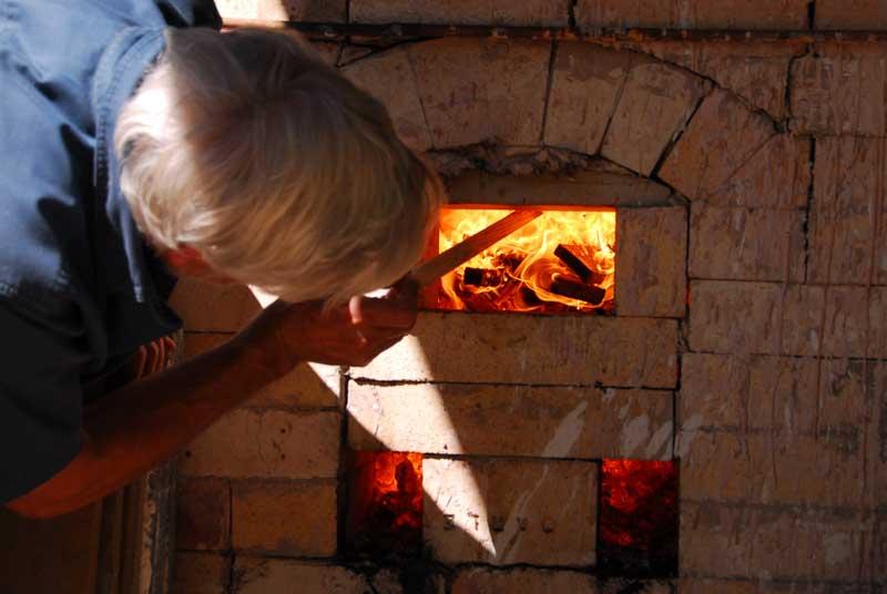 Stoking the kiln fire